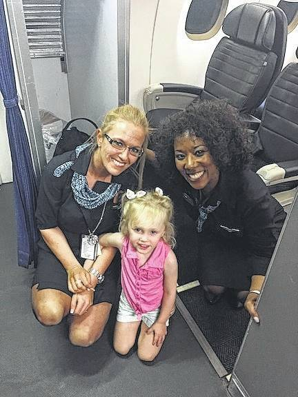 Stewardesses who made the flight pleasant despite the two-hour delay are April Wood and Dejuana Lockhart. Avery Brooke-Ryan handed out snacks and help the flight crew during the delay.