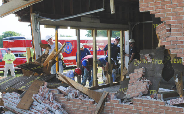 Central Ohio firefighters trained for rescues from collapsed structures recently in homes that are scheduled for demolition in Delaware. A car crash in the side of the garage was the scenario for the firefighters who had to build bracing to keep the structure from collapsing.