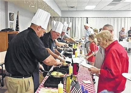 Sheriff John Hinton serving Betty Ritchey during the Celebrity Chef Omelette Breakfast held on Saturday morning. Donations continue to come in, with the total amount raised to be announced.