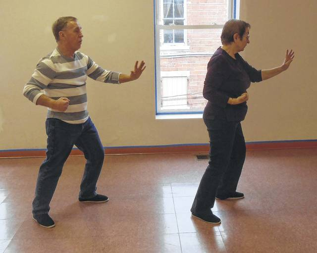 Tai Chi Instructors Marlene and Steve Renick demonstrate one of their moves. Tai Chi exercises benefit balance, coordination, reduce falls and relieve arthritis.