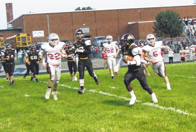 Northmor's Demetrius Johnson had a big day in his team's 41-8 win over Fredericktown. The senior quarterback rushed for four touchdowns and passed for a fifth.