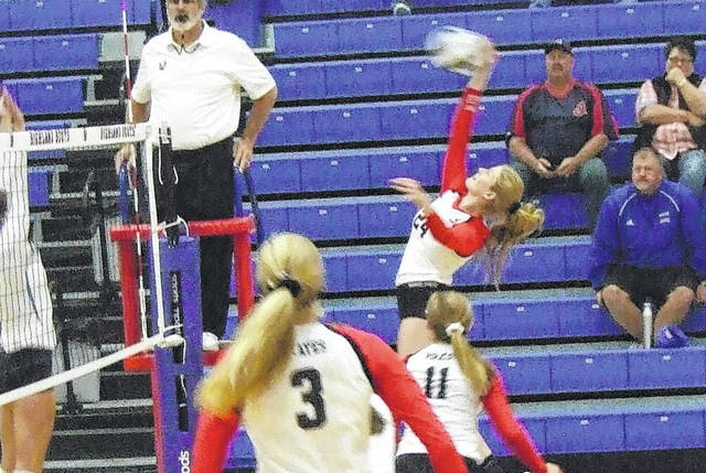 Kyndall Spires reaches up to hit the ball in Cardington's Tuesday contest at Highland.