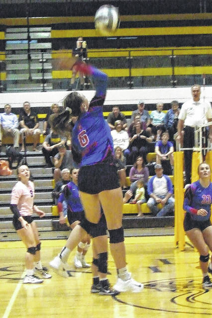Highland's Makenna Belcher goes up for a hit in her team's thrilling five-set win over Northmor in a battle of undefeated volleyball teams.