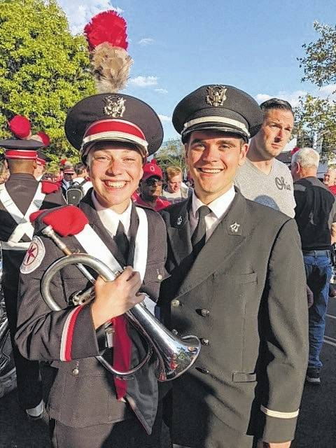 Mallory Cooper, daughter of Tom Cooper and Lee Ann Cooper of Marengo, is a freshman at OSU and a 2017 Mount Gilead graduate. She made the OSU Marching Band and plays the flugelhorn. She is shown with Todd Fessler, former Mount Gilead band director. He is working on his master's degree at OSU and is one of the graduate assistant band directors.