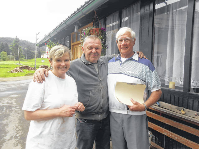 Sonja and Mika Mus with Allen Stojkovic at the Mus home and bakery. The church in Ribnik, Croatia, where Allen's father obtained family birth records is in the background.