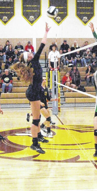 Anna Donner goes up for a kill attempt in her Northmor team's thrilling five-set win over Newark Catholic Tuesday.