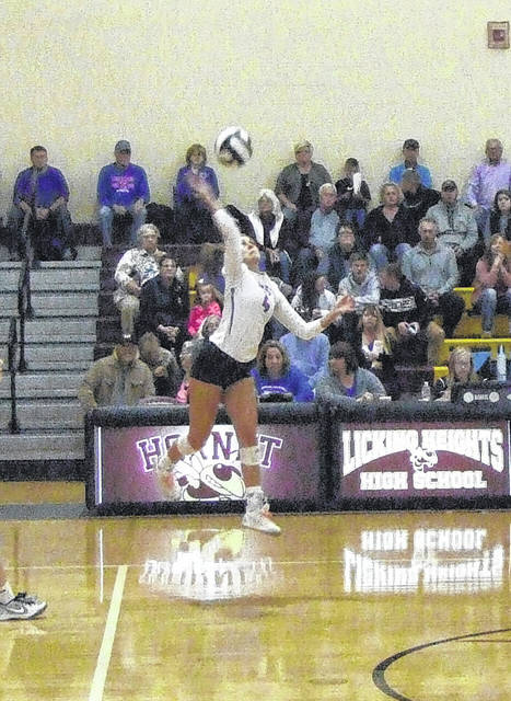 Bailey Santo records a hit in Highland's three-set win over Whitehall Wednesday.
