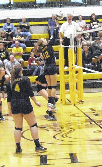 Rob Hamilton | Morrow County Sentinel Northmor's Hope Miracle goes up for a kill attempt in her team's tournament win over Northridge Saturday.