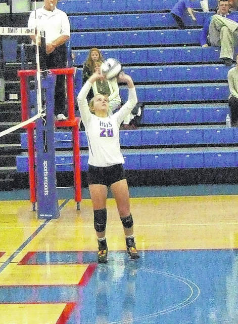 Highland's Parker Steck sets the ball in action from Wednesday.