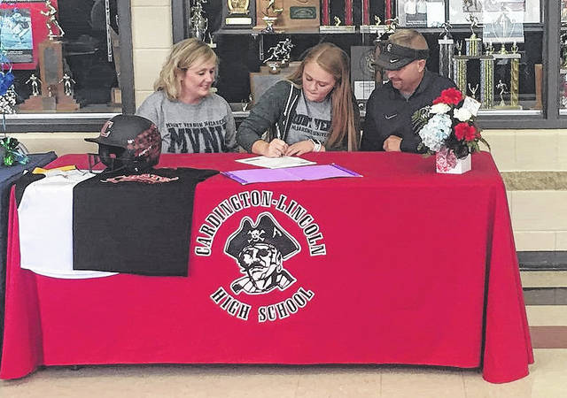 Cardington senior Rylie Partlow signs to play softball for Mount Vernon Nazarene University next year. Pictured with her are her mother, Atina, and father, Joel.
