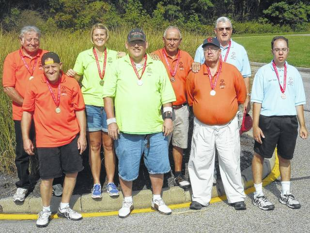Morrow County Special Olympics team members are, front row, from left, Jason Pryor, Dennis Payton, Glenn LaVan, Cody Cover. Back row, Larry Pryor, Andi Updike, Vinal Terry, Jim Trainer.