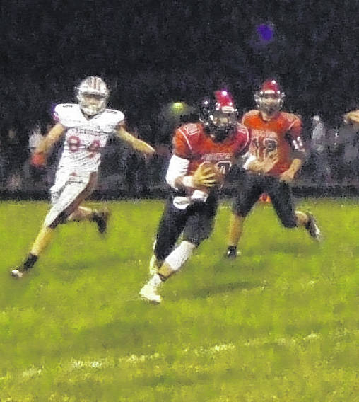 Cardington's Ty Landon scrambles for yards in his team's Friday night contest with Fredericktown.