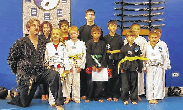 Wolfpak Martial Arts held a belt test on Sept. 21. Pictured are, back row (l-r): Aria Wright, Justin Berthold, assistant instructor Justin Burkey, Colton Peters, William Lucki and Quillian Rocks. Front row: Master Sam Wolf, Chessa Redman, Nathan Collins, Cohan Hurst, Braylin Romshak and Brycen Gaberial.
