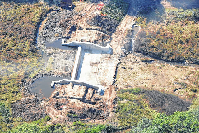 An aerial photo of the Mount Gilead State Park Upper Dam, under construction, taken in October. Substantial completion of dam and spillway improvements are scheduled for the end of 2017. Workers are near completion of rebuilding a new earthen embankment dam that will impound the lake. Work continues on finishing construction of a new spillway which features a labyrinth weir system. Also on the schedule is to install safety guardrails, a pedestrian trail, an information kiosk, park benches, fishing line collectors and a new kayak launch. Improvements also continue to be made on the lake's Upper Dam that includes a recapped spillway and a safety guardrail and handrails, according to the Ohio Department of Natural Resources.