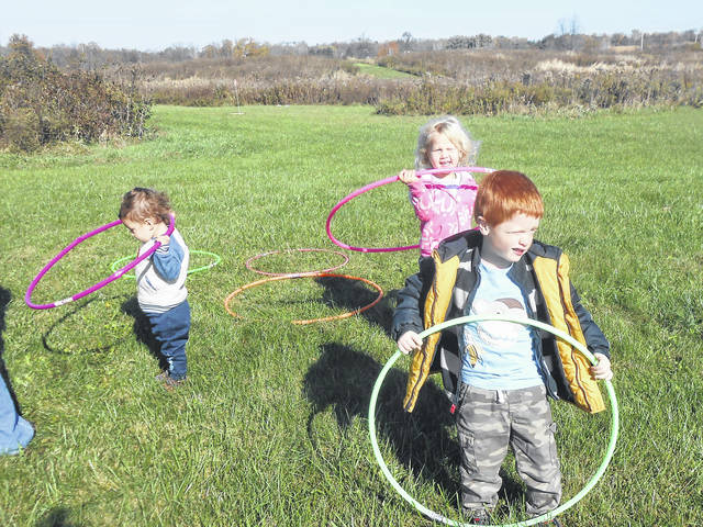 Children try their hand with hula hoops at the Wee Discover picnic.