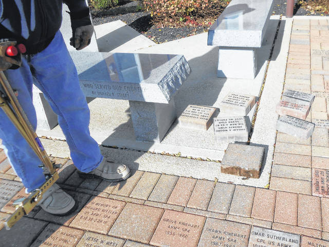 Veterans gathered at the Veterans Memorial east of the Court House to mark the 10th anniversary of the memorial. Shown, from left, are John Shade, Frank Hickman, Ryan Lawson, Steve Dowalter, Vaughn Corwin, Duane Cottrell, Allen Stojkovic, Bill Young and Bruce Fissell. Seven bricks were placed in the Veterans Memorial last week. Memorial bricks are in two sizes and are placed at the memorial courtyard twice a year.