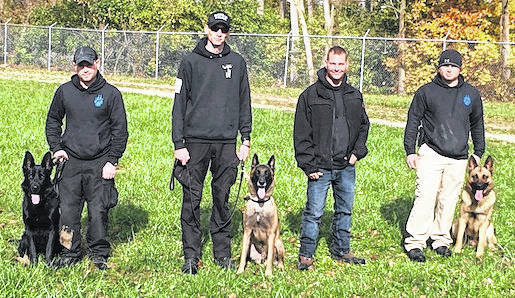Sergeant Thomas Cronenwett of the Mount Gilead Police Department has been given the opportunity to help train two police K9s for the Mansfield City Police Department. Once the K9s complete their training they will be certified in narcotic detection, tracking, building searches and suspect apprehension. Cronenwett also helped trained Danville Police Officer John Cox with the skills needed to be a K9 officer. Officer Cox and his K9 TC recently became certified on Nov. 3. Pictured, from left, is Mansfield Officer Zac Miller and K9 Dani, Danville Officer John Cox and K9 TC, Sergeant Thomas Cronenwett, Mansfield Officer Josh Frech and K9 Ferro.
