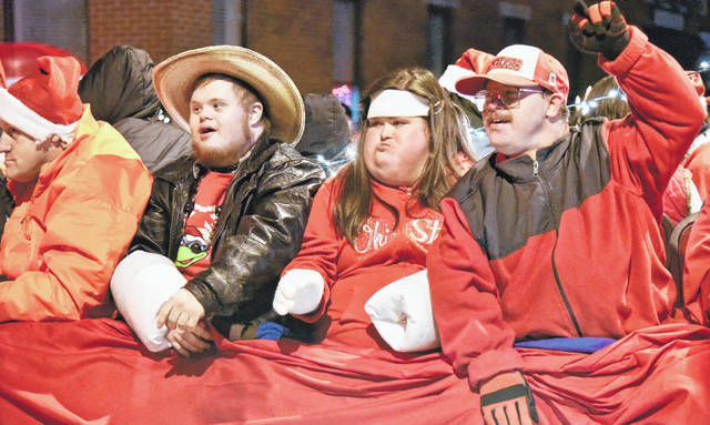 The annual Christmas Parade, sponsored by the Morrow County Chamber of Commerce, took place Friday night. Santa Claus made an appearance, along with numerous floats before a large crowd downtown despite chilly conditions. More photos online at morrowcountysentinel.com.