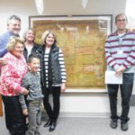 Irons family presents historical map to library