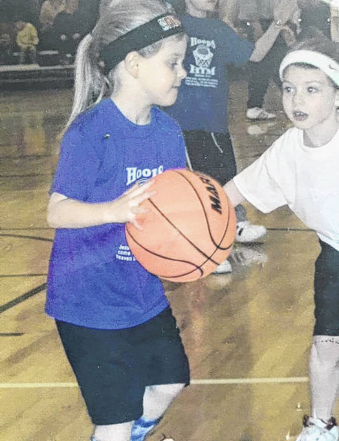 With four girls on his 2017-18 basketball team either committed to play in college or in the process of picking their school, head coach Jamie Edwards noted that those players had shown that potential since beginning in the sport, as evidenced by this picture of Kynlee Edwards and Sage Brannon competing in the youth Hoops for Him program.