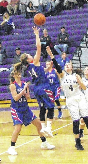 Highland's Erica Sardinha drives inside for a shot attempt at Mount Gilead on Saturday.