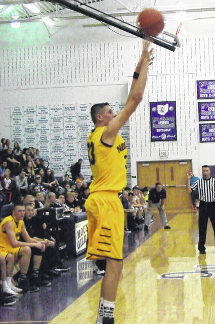 Kyle Kegley launches a three-pointer for Northmor on his way to finishing with a game-high 21 points Friday.