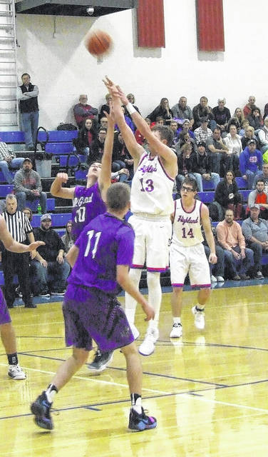 Highland's Mack Anglin puts up a jumper in his team's KMAC win over Mount Gilead Friday.