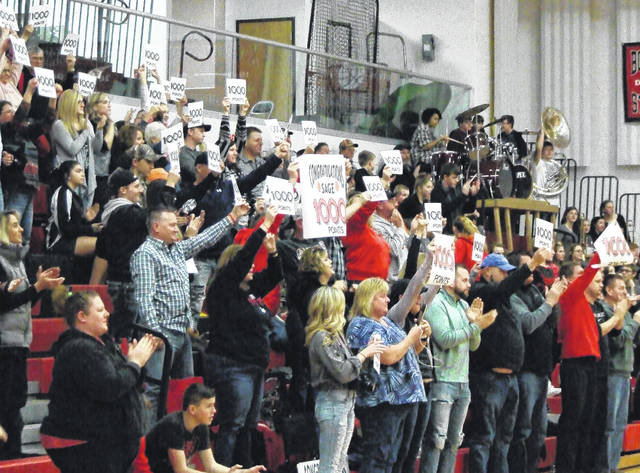 Cardington fans celebrate after senior Sage Brannon passed the 1000-point mark in Saturday's win over East Knox.