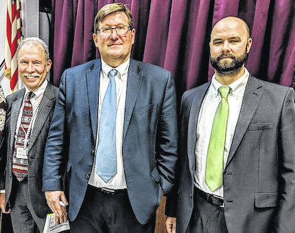 Probation Officer Andrew Szteiter and Judges Robert Hickson and Thomas Elkin spoke at drug court graduation about the mission and value of the drug court program.