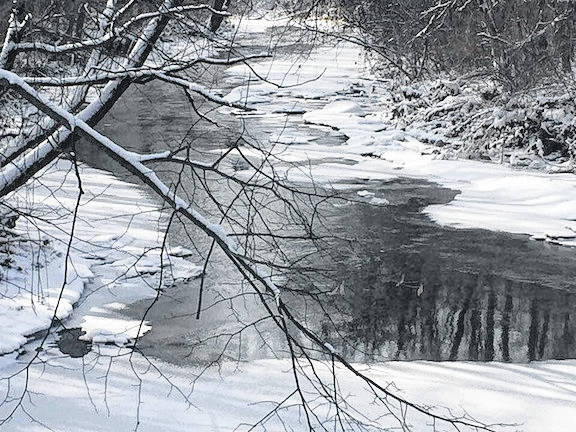 Snow and ice are visible along Whetstone Creek running under Township Road 99 this week.