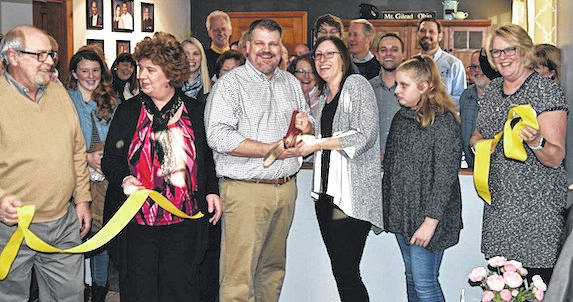 CENTURY 21 Gold Standard held a ribbon cutting Thursday and hosted a Chamber of Commerce business after hours event. Chris and Leigh Conant took over ownership and leadership of the company effective Aug. 1, to allow Bob and Darlene McElroy more time to spend with family and travel. The office continues to be a family-owned company serving central Ohio for almost 40 years. A proclamation was read by the Secretary of State's office prior to the ribbon cutting.