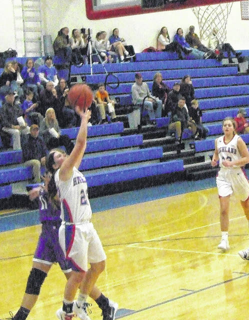 Madison Cecil drives for a basket against Mount Gilead Thursday.
