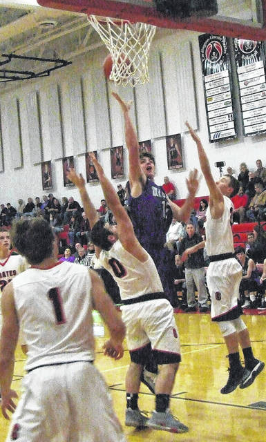 Mason Mollohan works inside for a basket in Mount Gilead's Saturday night win at Cardington.