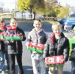 First graders pack shoe boxes