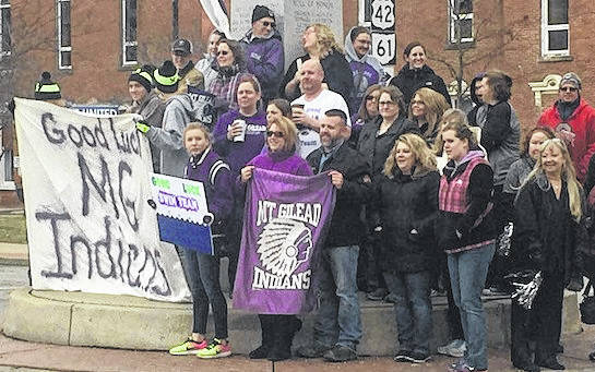 Supporters of Mount Gilead High School swim team gathered for a sendoff on the square Friday morning. The team is headed to Athens for Division II district competition this afternoon.