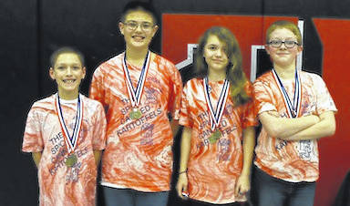 The Mount Gilead Middle School Destination Imagination team placed first in the Regional Tournament held the weekend of February 24-25 and the Da Vinci Award, a special honor for outstanding creativity and thinking outside the box. The team performed a presentation explaining the canned food drive they had conducted in November and doing it from the cans' perspective. The team advances to the State Tournament March 24. Pictured, from left, are Collin Gabriel, Samuel Baer, Samantha Keman, and Aydyn Newsome. Not pictured is Joel Conrad.