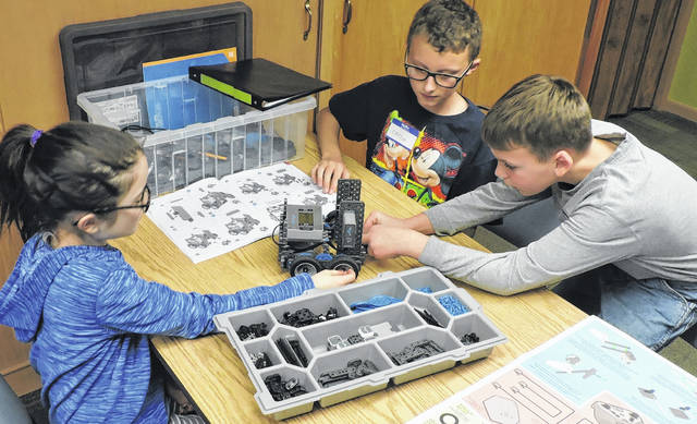 Kathryn Loeffler, Carson Kessler, and Chase Jordan build a robot at Selover Library.