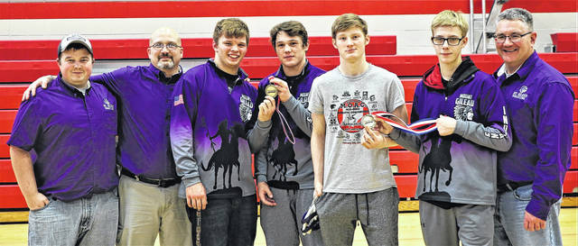 Four Mount Gilead wrestlers claimed first place in their weight class at the KMAC championships hosted by Centerburg Saturday. Pictured are (l-r): assistant coaches Ben Saunders and Scott Page, Hunter Trimmer (182 champ), Brandon Strickland (170), Nate Weaver (132), Josh Sullivan (113) and head coach Mike Williamson.