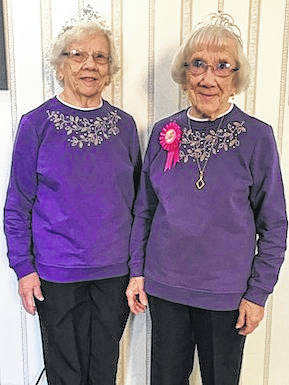 """Pictured are twins Elizabeth """"Libby"""" Davis (right) and Evelyn (Davis) Shoults who celebrated their 90th birthdays Jan. 18 at Kingston Residence of Marion. Libby and Evelyn were born at home in Westfield, Ohio and were delivered by a young Dr. Davis (no relation). No one knew there were twins and after Libby was delivered everyone got the surprise of Evelyn coming 30 minutes later. Libby and Evelyn lived in Ohio their entire lives with Evelyn living in Morrow County for all of her 90 years. After high school both worked at HPM and later both worked at the Marion Power Shovel. Evelyn also worked at the Mt. Gilead School for 25 years and married Jim Shoults. Libby retired from the Shovel after 46 years. Libby resides at Kingston Residence of Marion and Evelyn resides at her home in Mount Gilead."""