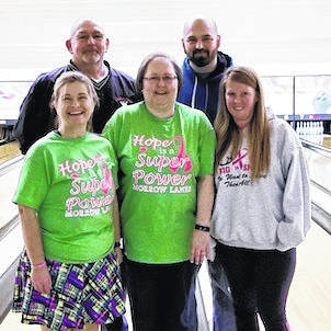 Winning team at Bowl for the Cure are, back row, from left: Jim Patterson and Andrew Kennedy. Front row, Sierra Smith, Carol Patterson and Tracy Zeigler.