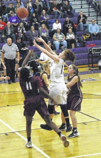Mount Gilead's Madison Fitzpatrick goes up for two of her team-high 12 points in Thursday night's sectional basketball contest at home with Columbus Academy.