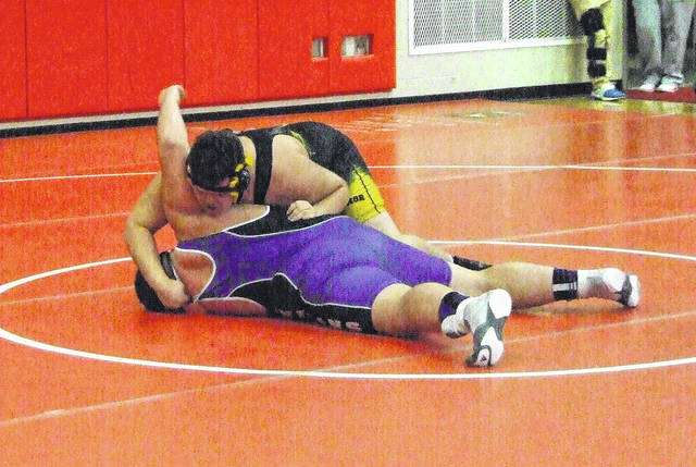 Tyson Moore of Northmor looks to turn Mount Gilead's Kaleb Miller in a 285-pound bout on Saturday.