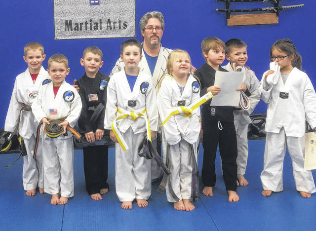 Wolfpak Martial Arts recently had promotions in their kids' class. Pictured are, back row (l-r): Mason Kirkpatrick, Galen Wright, Master Sam Wolf and Tristan Casto. Front row: Owen Kirkpatrick, Jase Barlow, Channing Redman, Cillian Van Romer and Nadia Carter.