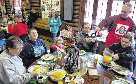 This family was dining at the LMC Maple Syrup Festival Sunday, March 11. From left, are Barbara Osborne, Kathie Townsend, Aliauna Kirkpatrick, Keith Townsend with his brother, Dan Townsend pouring coffee and Katie Townsend. This is a four-generation family who was attending the Lutheran Memorial annual pancake event for the first time.