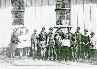 Mrs. Burns was a teacher at Mount Gilead, but before that she taught at this Chestnut Grove one-room school on County Road 114 north of County Road 23 in Harmony Township about 1928. She is the one in the fur collar. She taught at least 46 years.