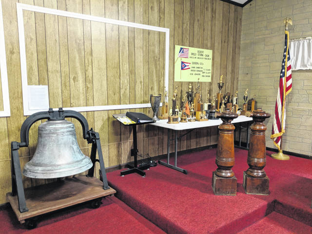 """Two banisters from Edison School were """"rescued"""" by Karon (Salisbury) Ridenour as the building was demolished. They are on display at the Edison Municipal Building with trophies and the school bell."""