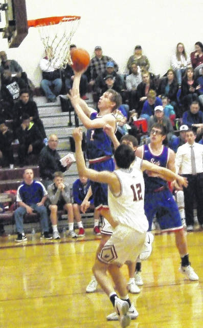Highland's Andrew Wheeler works inside for a lay-up against Bishop Watterson Saturday.