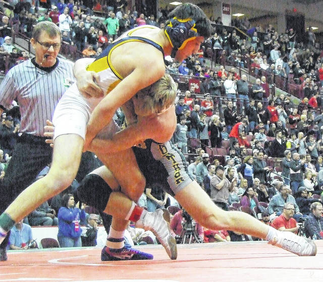 Northmor's Conan Becker fights for a takedown in the Division III 145-pound state finals Saturday night.