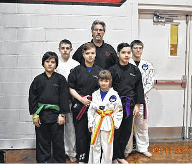Wolfpak Martial Arts brought home 14 golds, seven silvers and a bronze from the Gladiator Games Martial Arts Festival on Sunday, March 11. On Saturday, Feb. 24, at the Trudo Memorial Martial Arts Tournament, they brought home a total of 15 golds, seven silvers and seven bronze medals. Pictured are, back row (l-r): Logan Welsh, Master Sam Wolf and Justin Burkey. Middle row: Justin Berthold, Braylin Romshak and Hunter Berthold. Front: Caitlynn Berthold. Not pictured are coach Cody Levally, Galen Wright, Wes Stauffer and Casey Knipp.