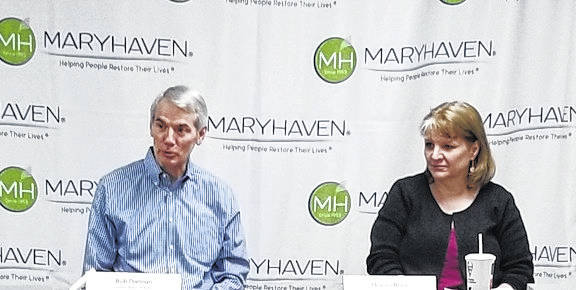 U.S. Senator Rob Portman and Deanna Brant, executive director at Delaware-Morrow Mental Health and Recovery Services Board, listen during a roundtable discussion at Maryhaven in Mount Gilead.